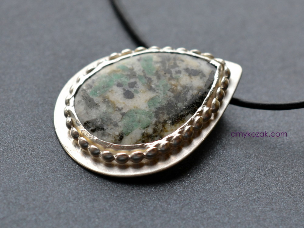 emerald and quartz pendant